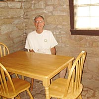 Dad in the dining area of the cabin